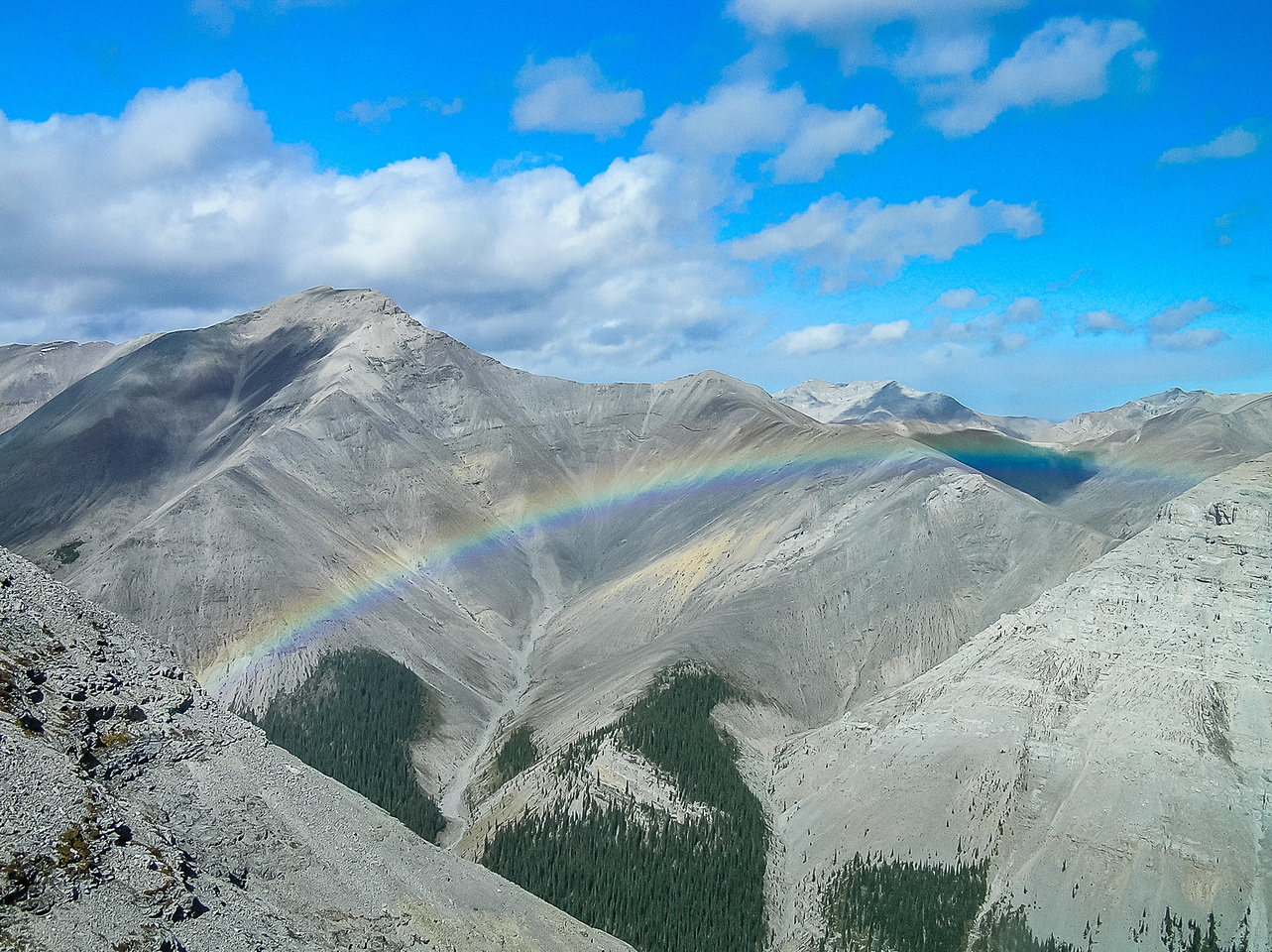 A rainbow and Mount Howard.