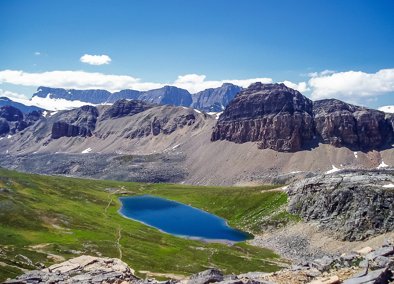 Lovely Helen Lake with Crystal Ridge and Crowfoot Mountain rising beyond.