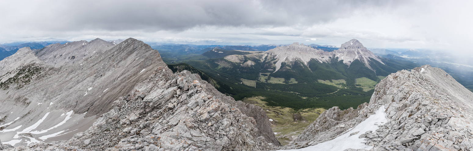 Summit pano with Seven Sisters & Crowsnest Mountain and Phil at right.