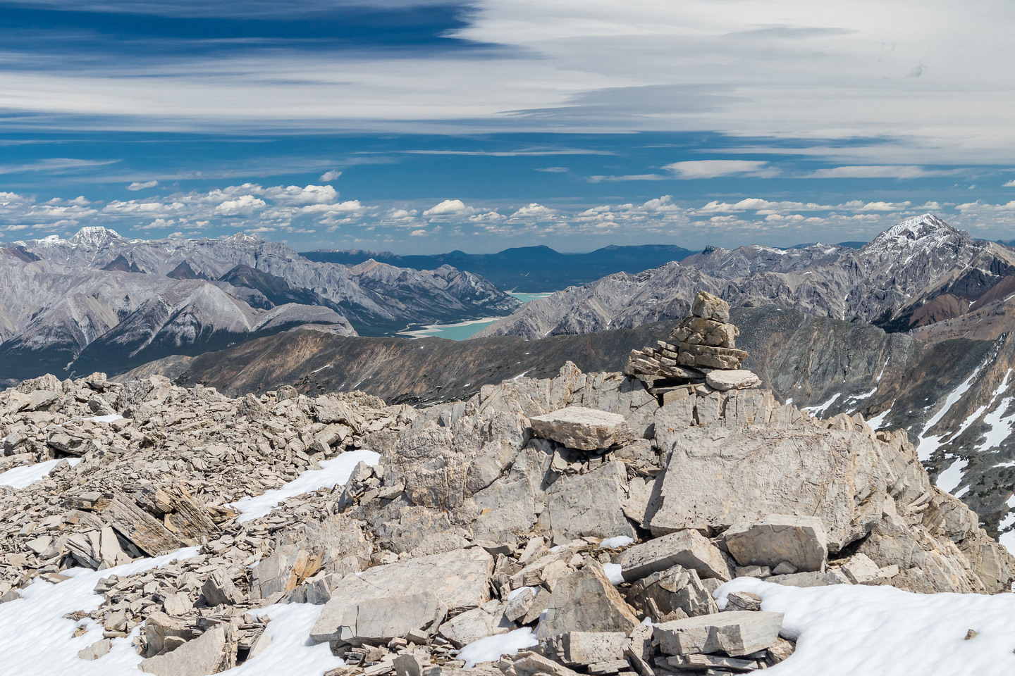 Views past the summit cairn towards Abraham Lake with Elliot Peak rising at right, Hangman at left.