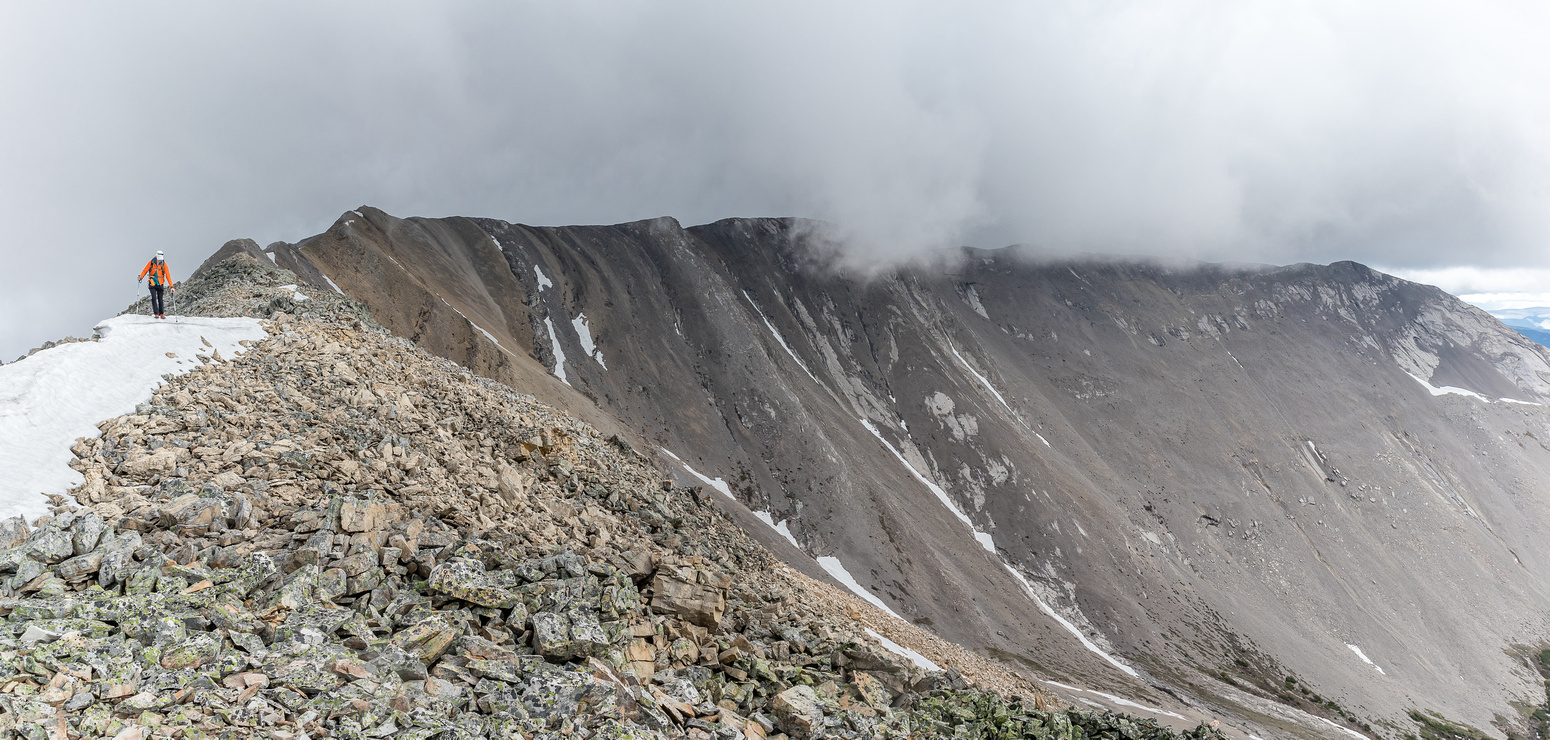 Clouds start pouring in over Mount Armstrong as we return along the SW ridge.