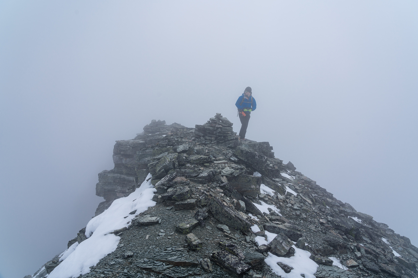 Phil in clouds at the summit of Mount Haig.