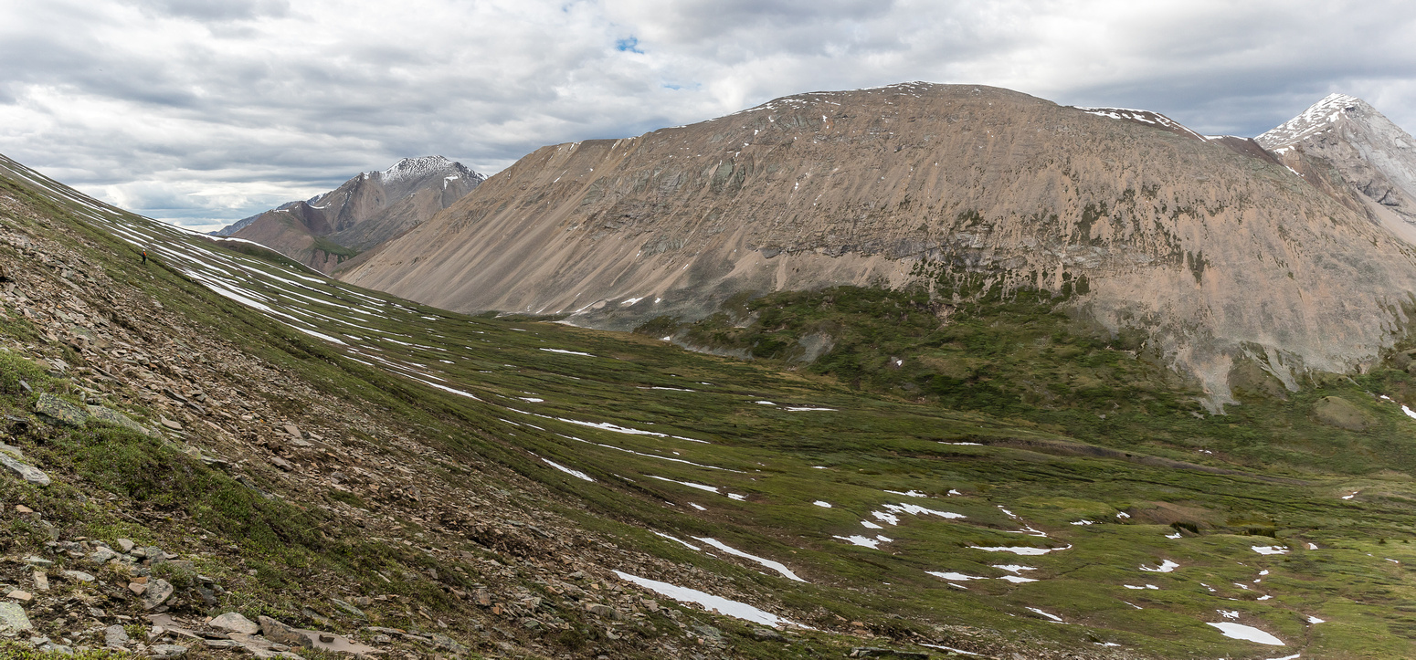 Views back to Divide Pass (L) from the east ascent slopes of Chirp Peak.