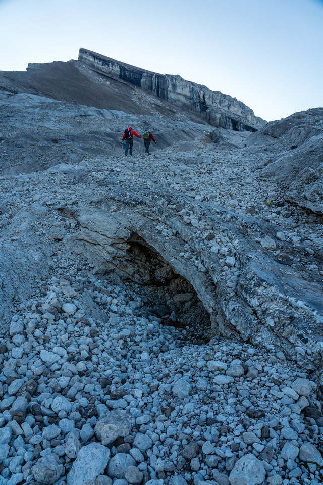 Ascending scree / slabs and frozen dirt to the Deluc Glacier.