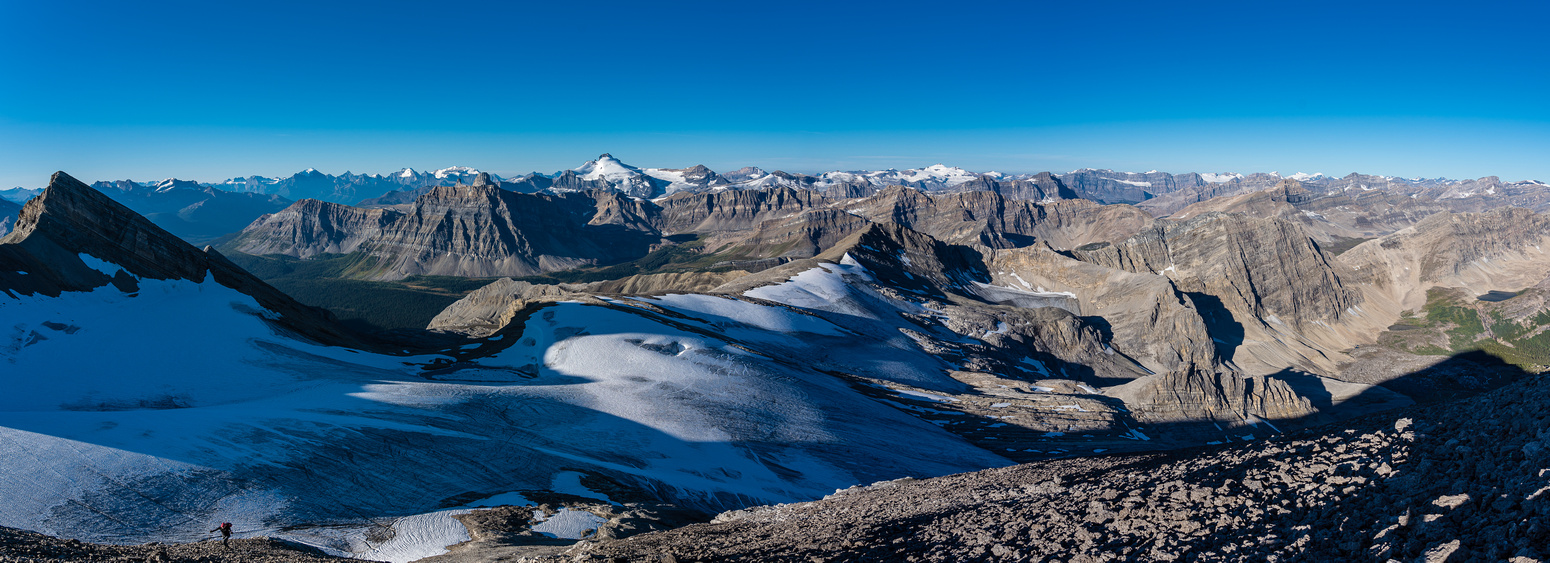 An incredible panorama of peaks starts to appear as we ascend the SW slopes of Deluc.