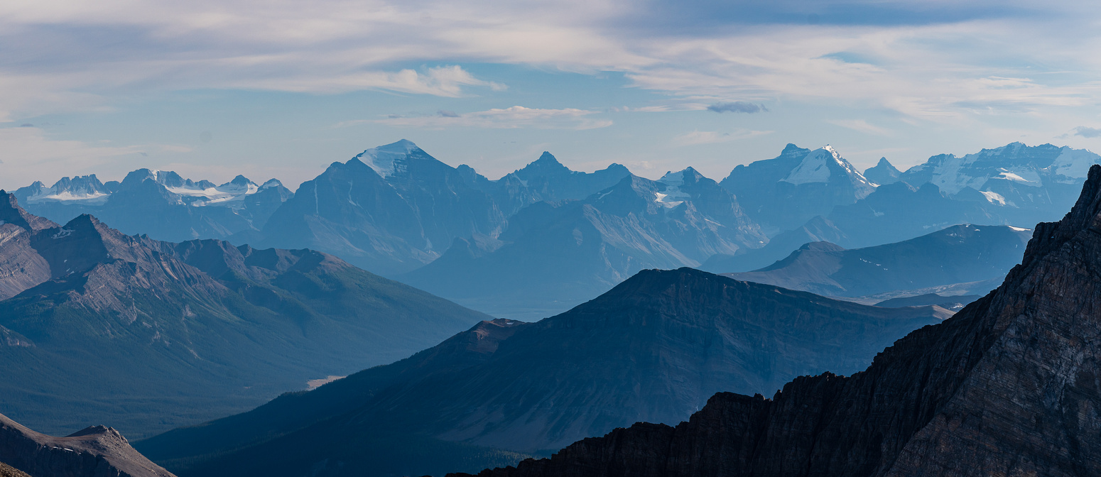 Lake Louise peaks including Mount Temple and Huber in the hazy distance.