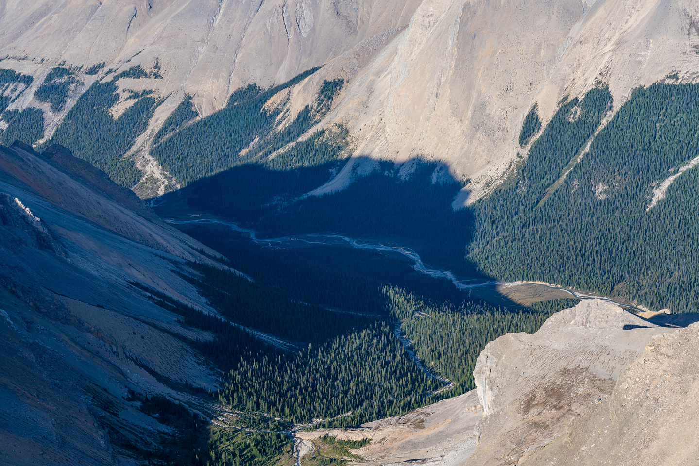 The Roaring Creek Valley sits hundreds of meters below to the east.