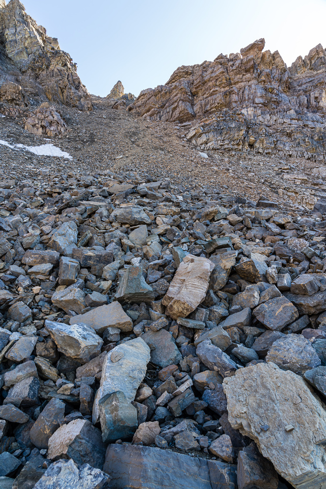 Ascending scree and boulders up north slopes of the Quartzite Col.