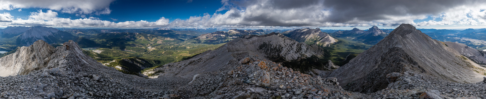 Summit views include Sentry (L), Erickson, Deadman, Allison ,Crowsnest and Tecumseh (R).