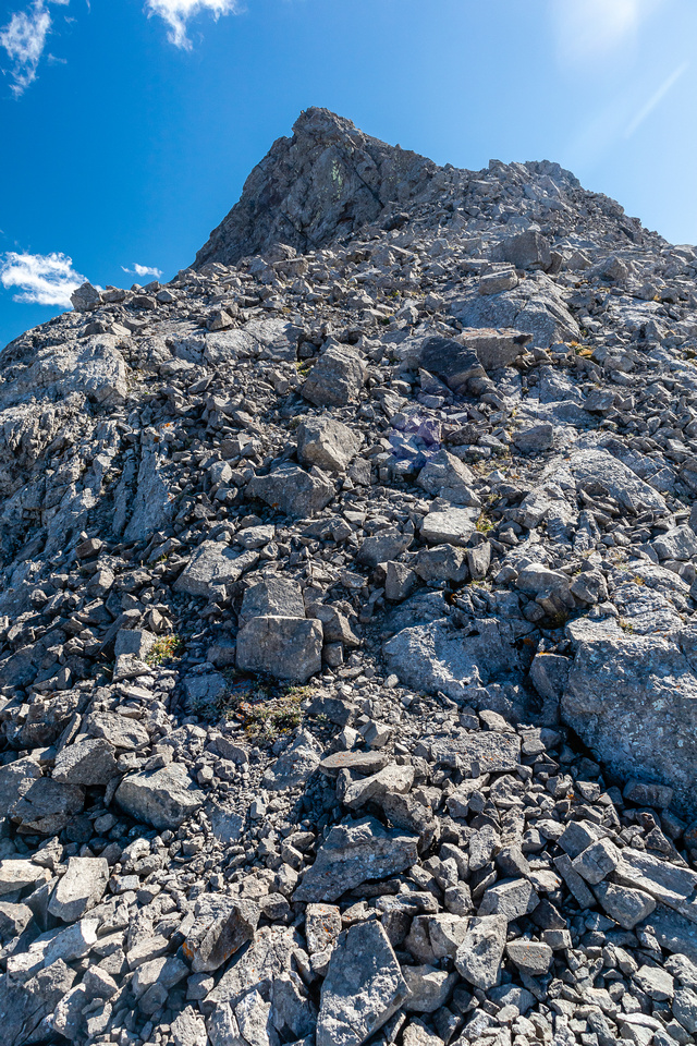 Ascending the north ridge of Ostracized Peak to the false summit.