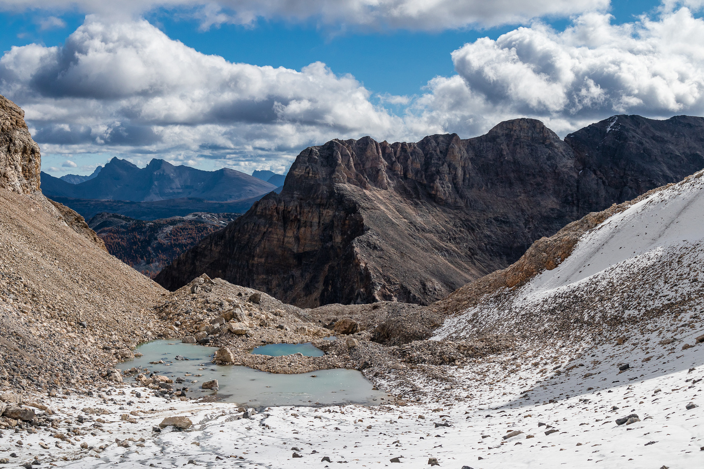 Views back over the glacial tarns to the unnamed peak east of Mummy Lake.