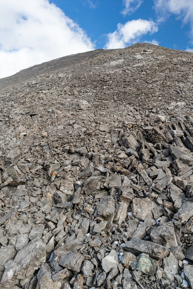 Grinding up scree on the west ridge.