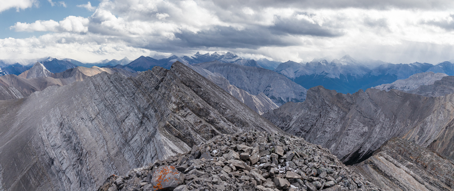 Views over the false summit towards Mount Lougheed and the Three Sisters (R).