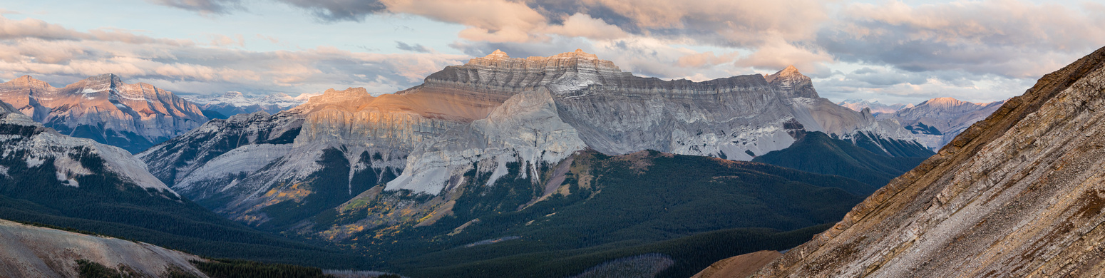 The Peechee / Girouard / Inglismaldie massif catches sunrise. Carrot Creek at left along with Mount Rundle.