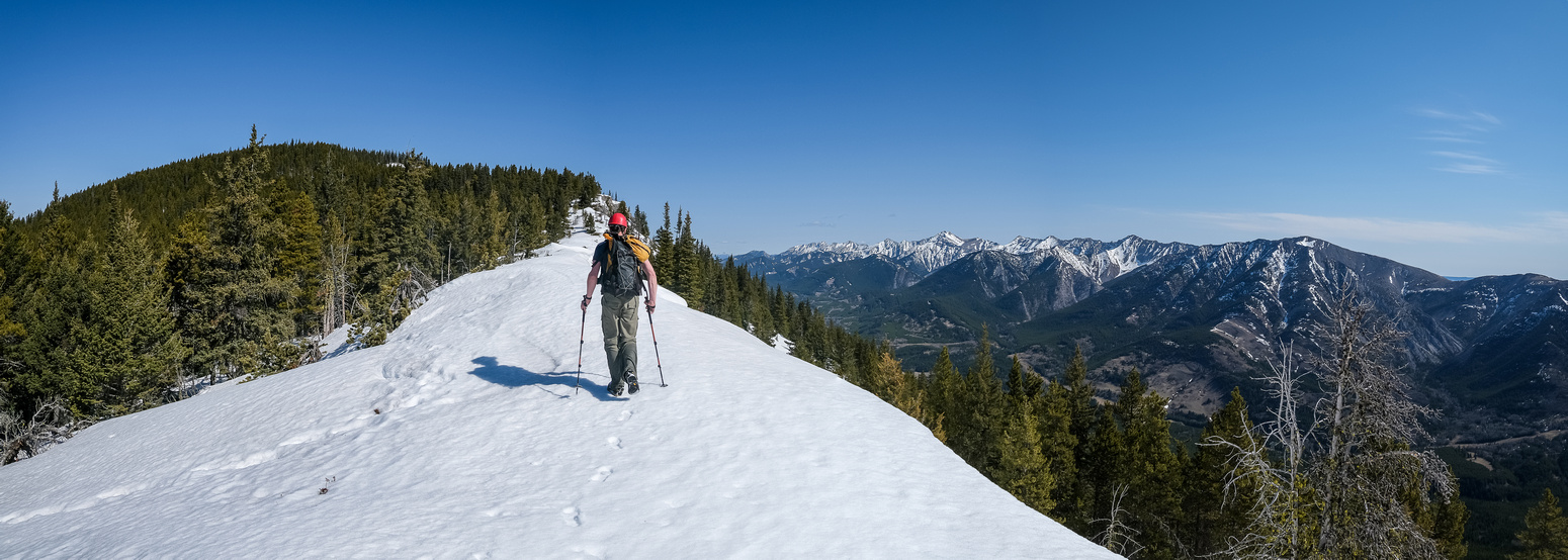 Hiking on semi-frozen snow to the summit of Bluff Mountain.