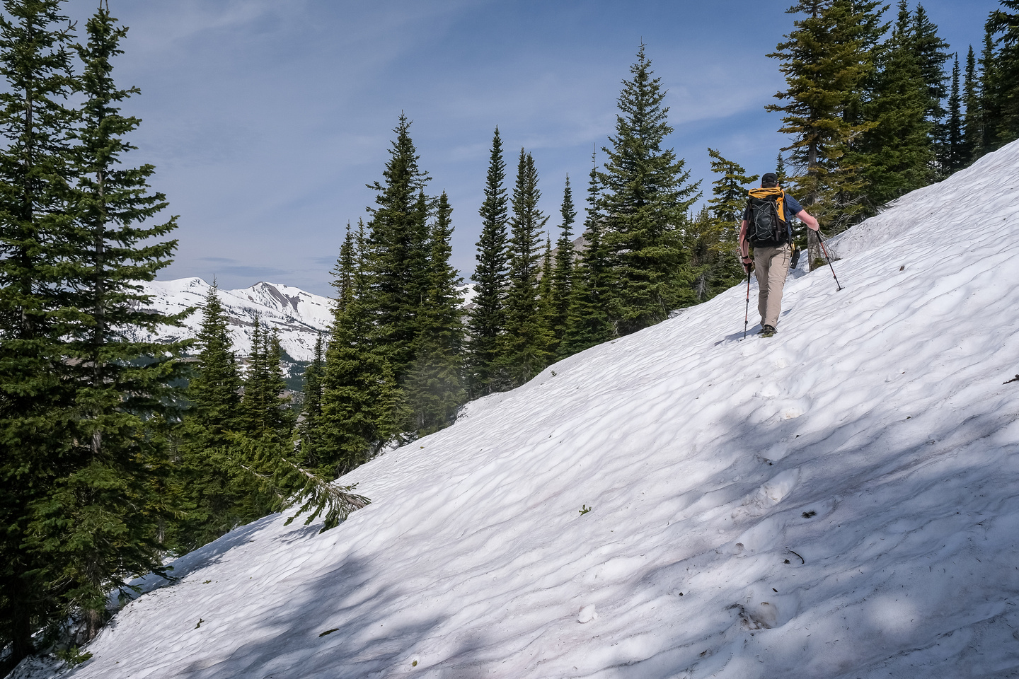 Traversing on snow slopes around the south aspect of the first false summit.