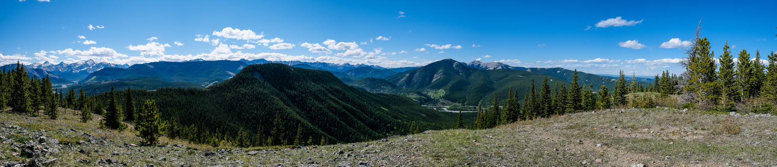 Views from Swany's Ridge looking west (L) and north include Elbow River, Powderface Ridge, Ipan, Prairie and Moose.