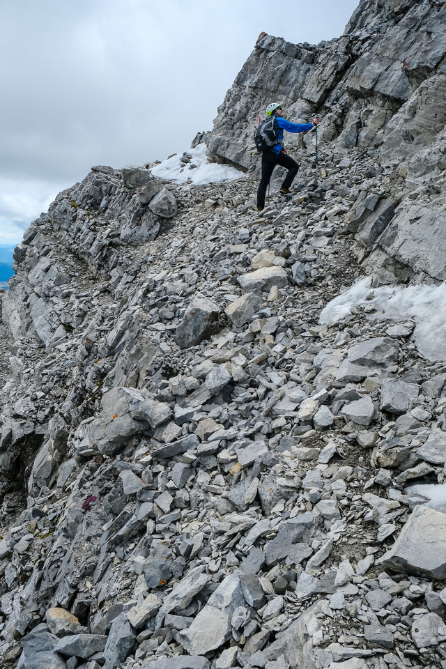A wider but more exposed scree ledge over the east face.