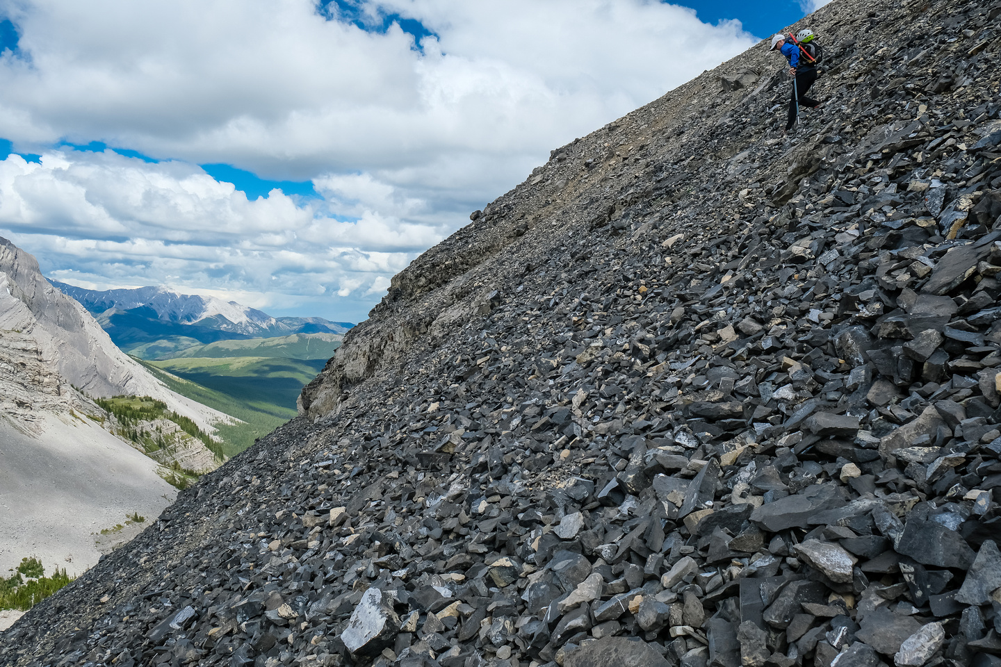 Continuing down steep scree slopes into a small hanging valley.