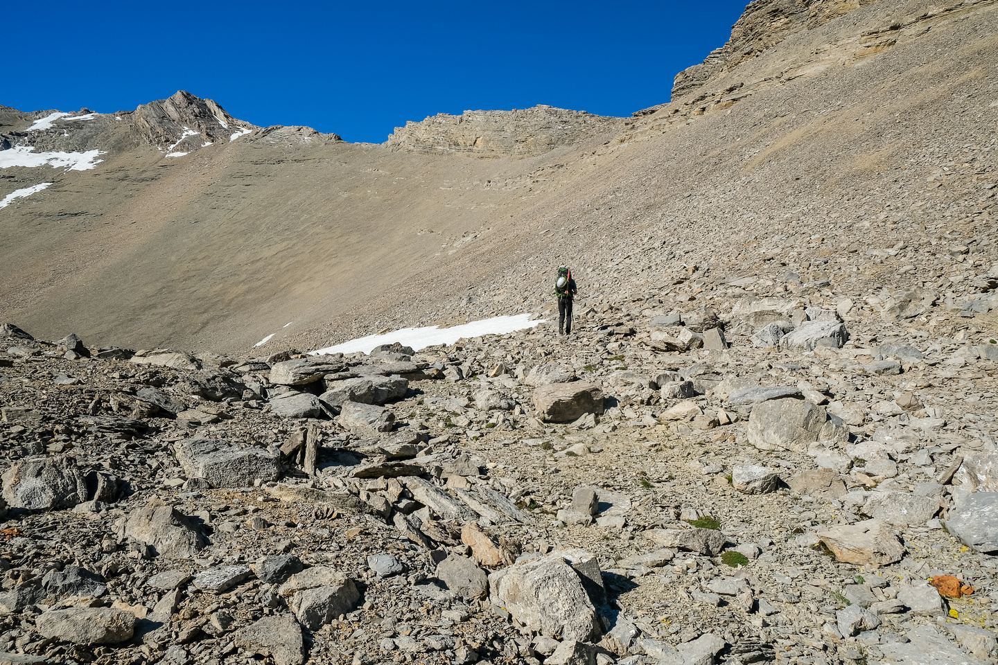 Hiking up loose shale and scree to the 2800m col at top center.