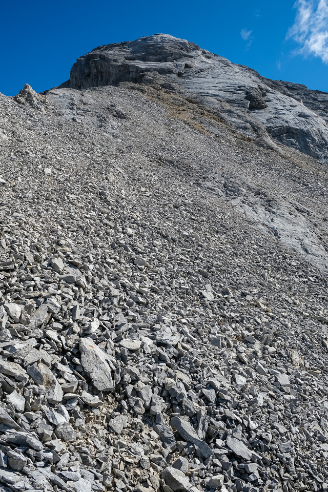 A highway in the scree leads folks directly to 4th class slabs under the summit. Go right instead...