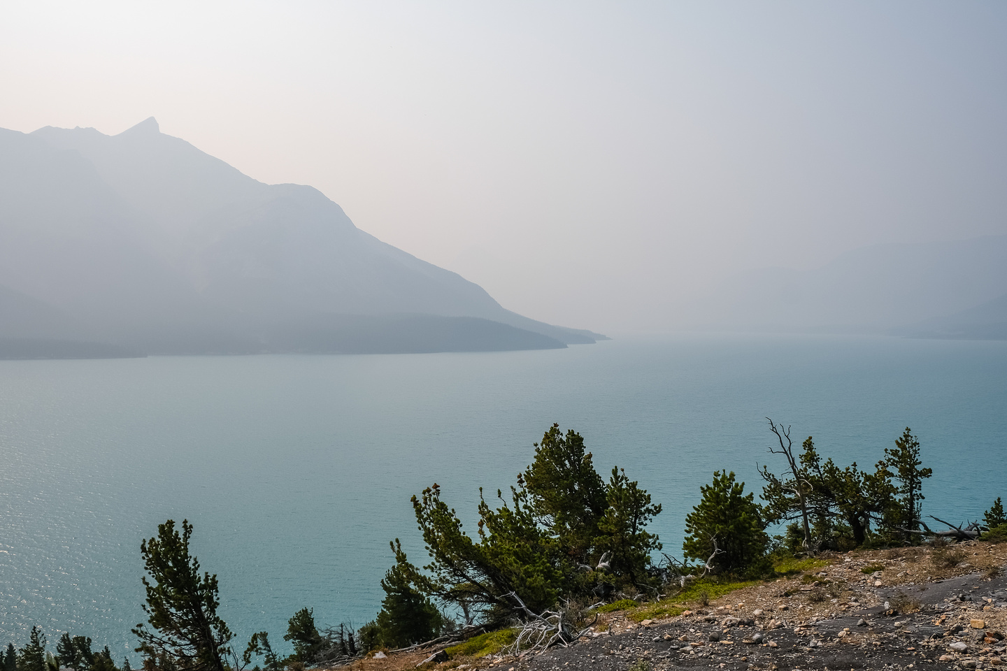 Mount Michener barely shows up over a smoky Abraham Lake.