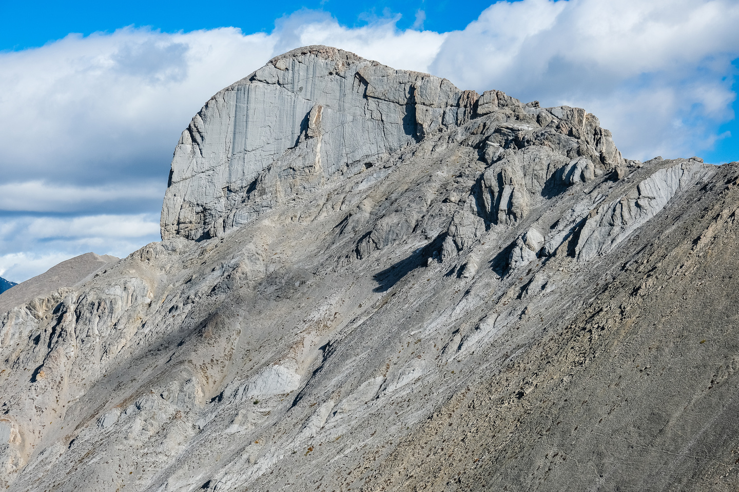 Marvel Peak has some impressive cliffs - our route goes up and right along a bench at its base.