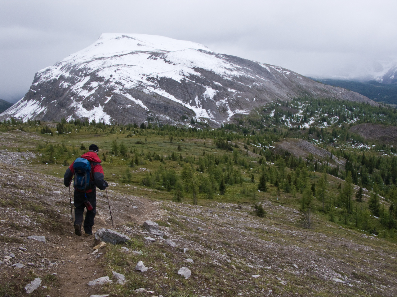 Descending to Og Pass with our second mountain (Cave) in the background.