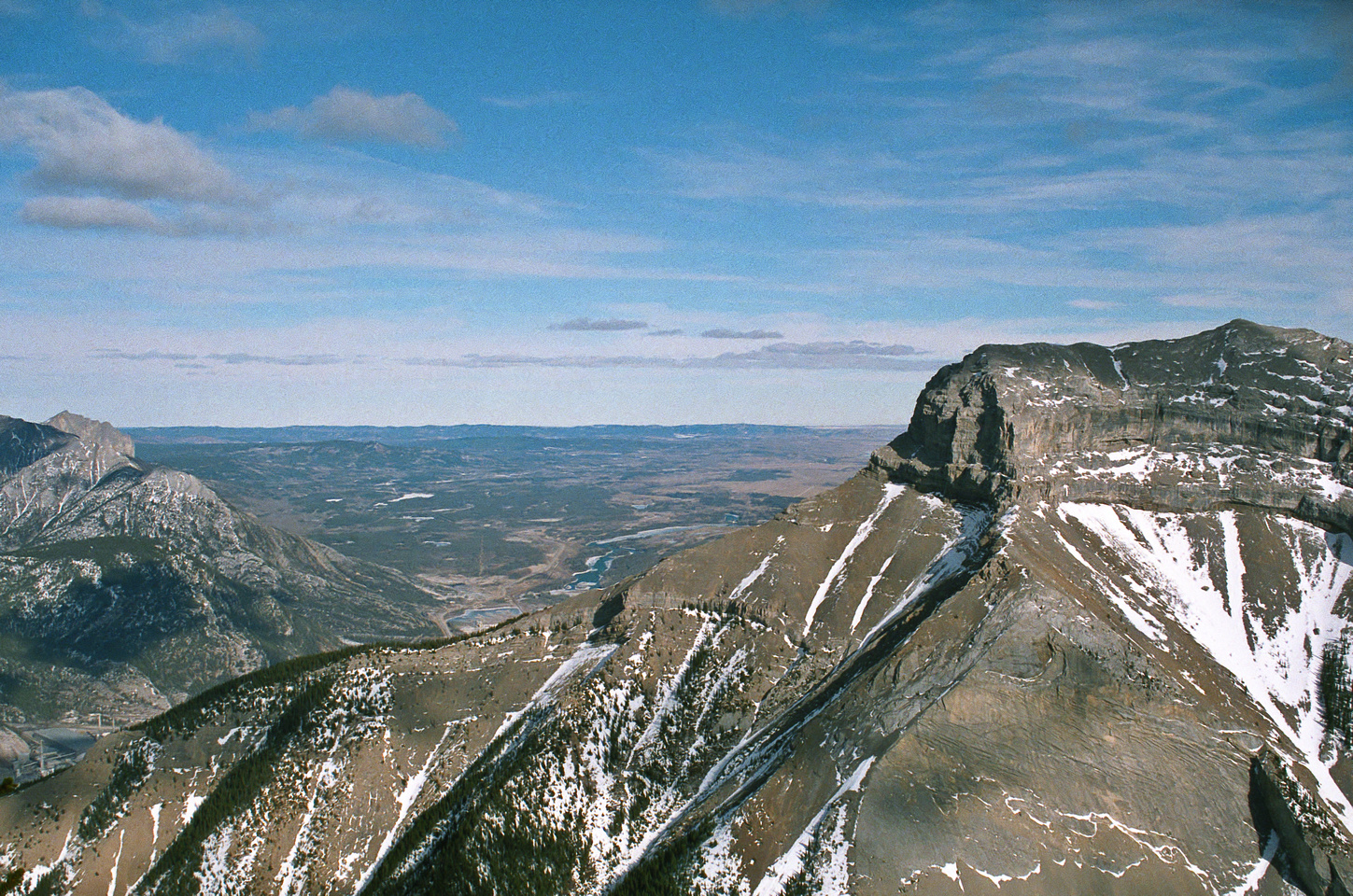 Looking past the north buttress of McGillivray to Yamnuska (L).