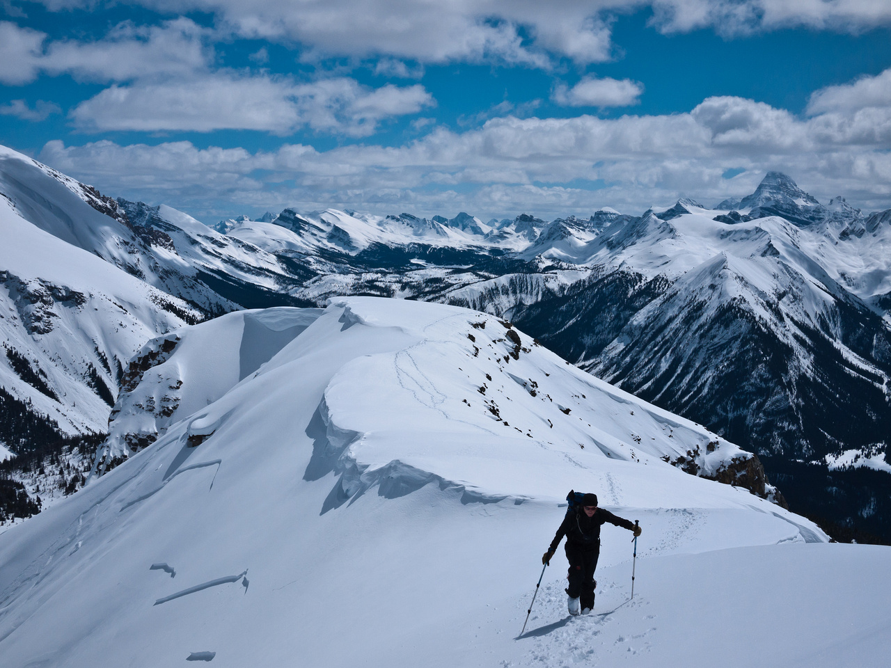 Traversing snow slopes to the summit.