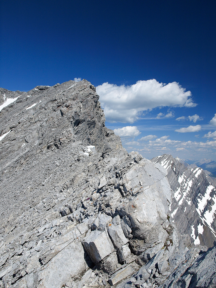 The only difficult scrambling is the exposed and loose summit ridge.
