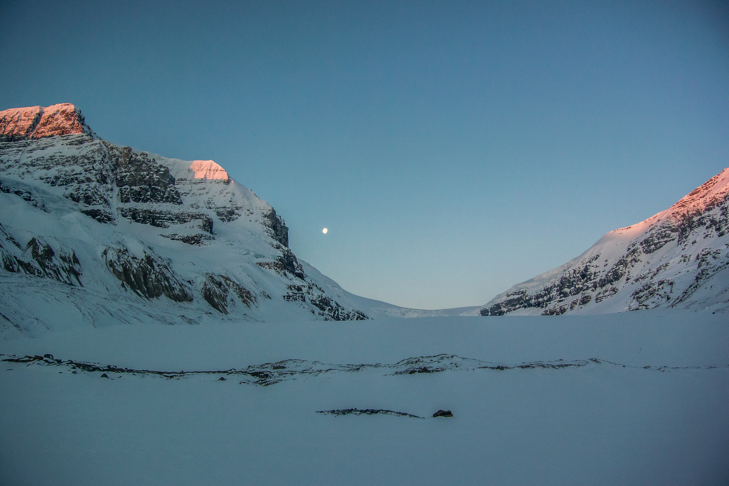Leaving the toe of the Athabasca Glacier in perfect weather. Skyladder on Andromeda is lighting up on the left.