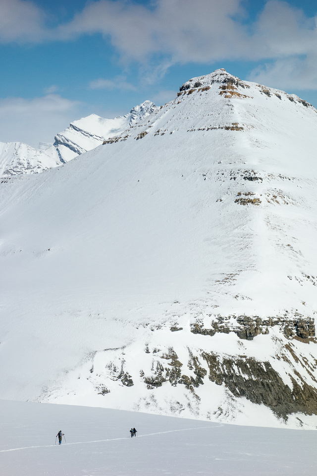Descending the icefield with Big Bend Peak looming above and our tracks coming down it's west flank.