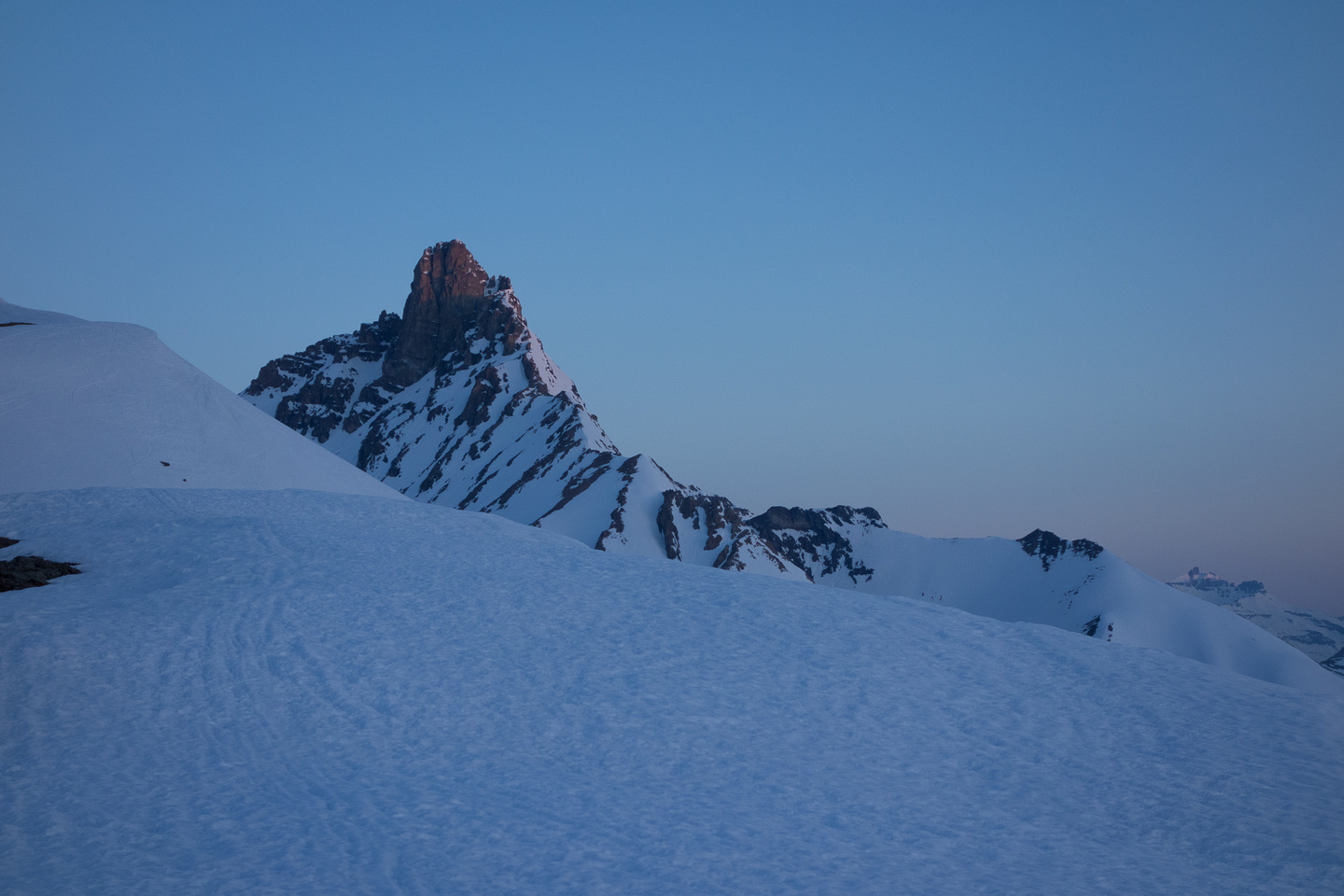 Hiking up the ridge in pre-dawn light on a firm snow crust. Hilda Peak visible here.