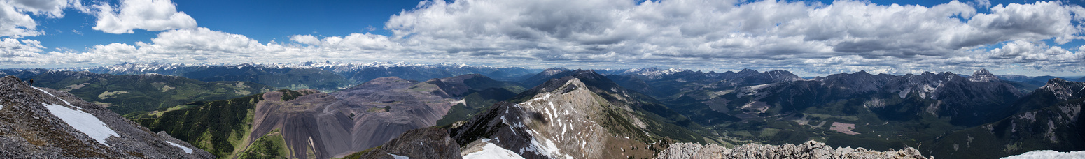 A huge panorama looking east (R), north (C) and west (L) along the Great Divide.