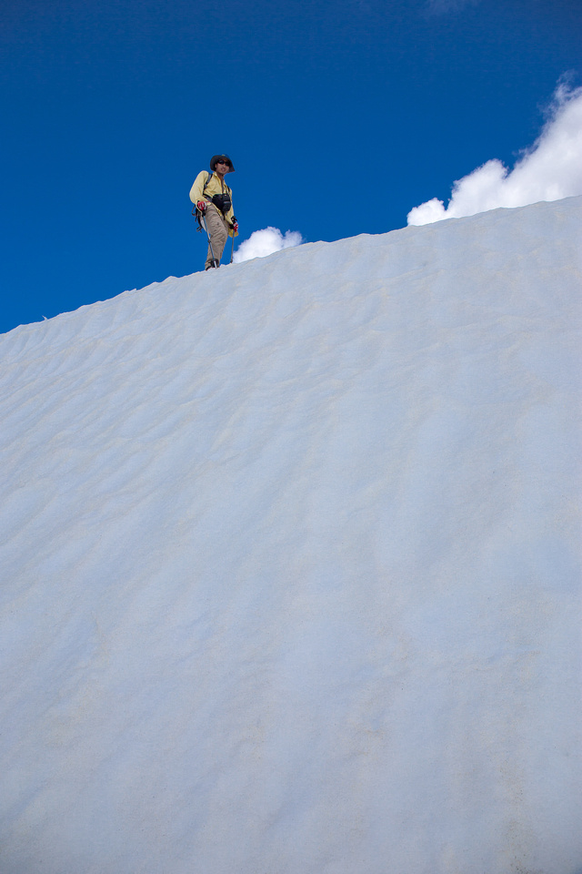 Ascending the summit snow banks.