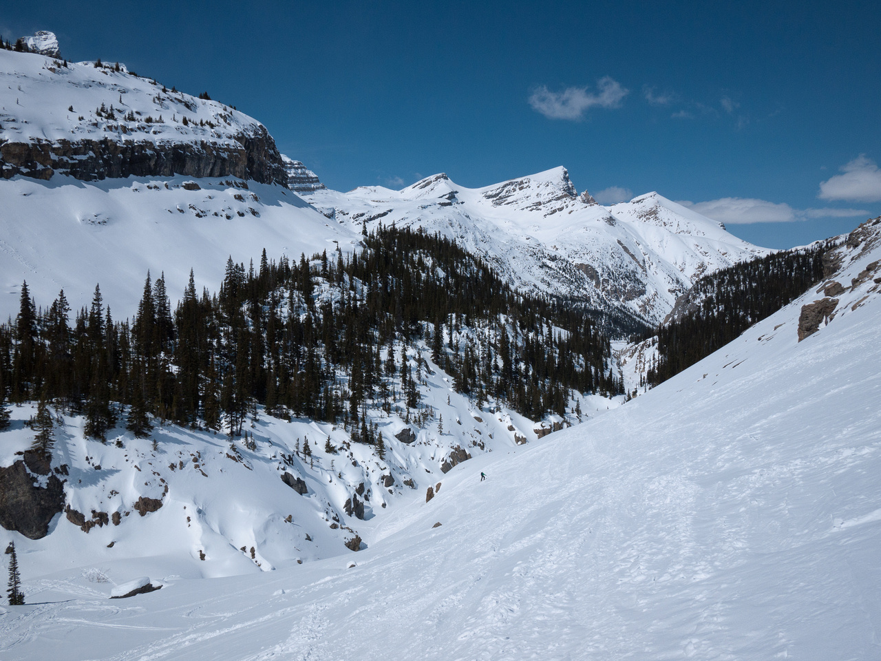Mike is dropping into the canyon. This is the riskiest avalanche slope we had to cross - but it was solid on this day.