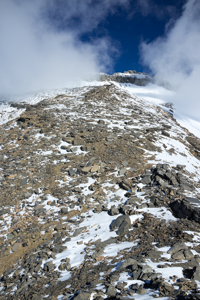 Looking up the dragon's back to Mumm Peak - note the building clouds?