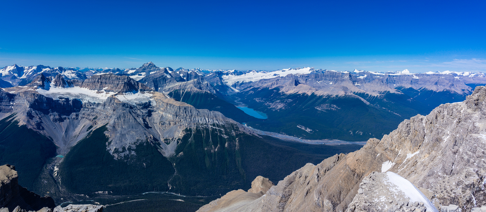Glacier Lake and the Lyell Icefield. Kaufmann Peaks and Sarbach at left with Forbes rising over them. Mount Columbia at far distant right.