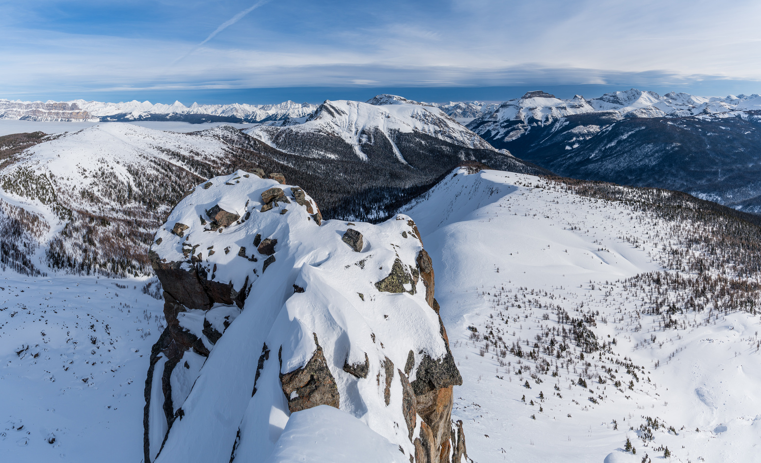 An exposed outcrop off the summit with Copper Mountain beyond.
