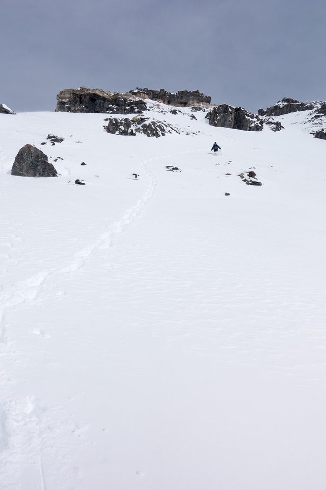 Wietse plunge-steps the snow slope above me.