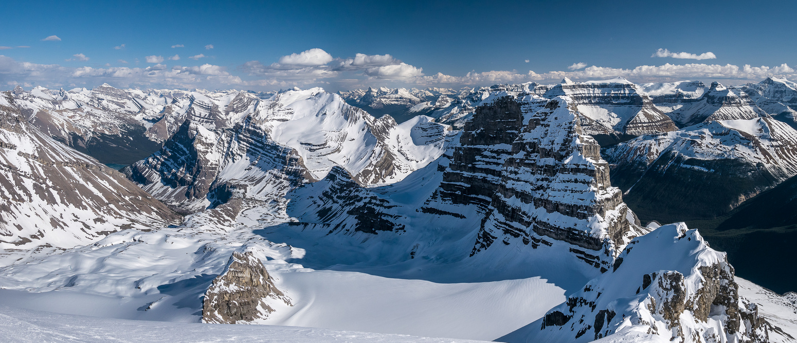 Another dramatic panorama of Eric coming up the south ridge of Cirrus with the two 'fins' behind him.