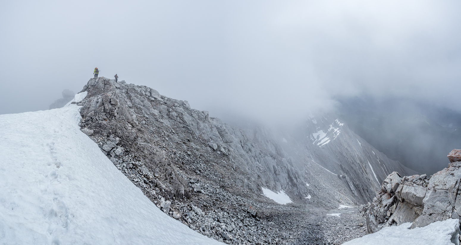 Leaving the top in swirling clouds and light snow.