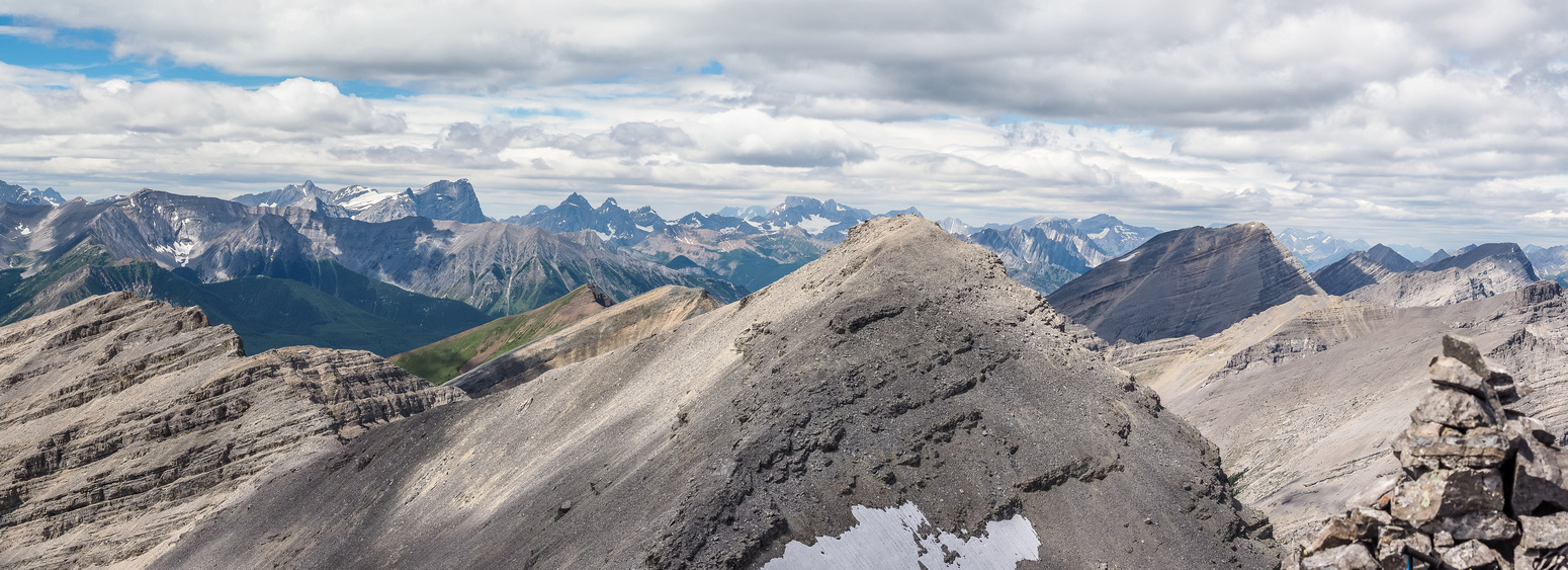 Looking north, back over the false summit with McPhail rising impressively at distant right. Abruzzi rising at left and Joffre at center distance.