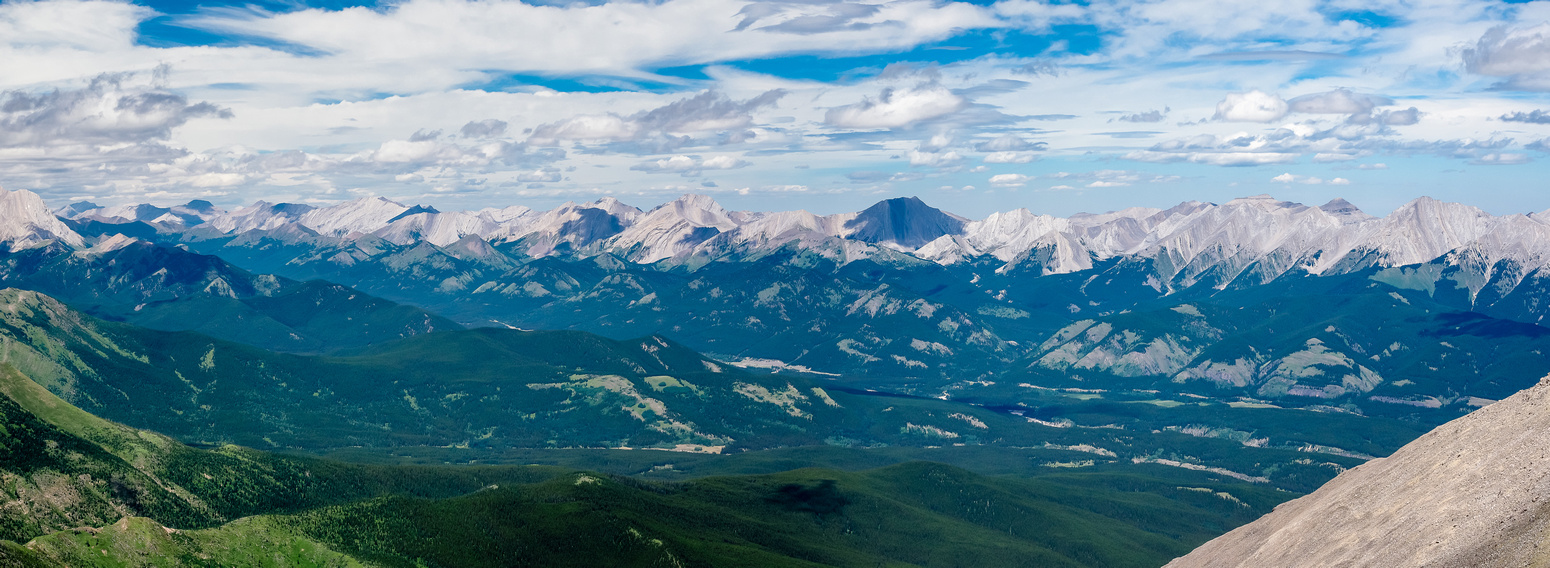Another view over the lush Highwood River Valley and Hwy 40 towards the Highwood Range at peaks including Serendipity, Patterson's and Lineham Peaks.
