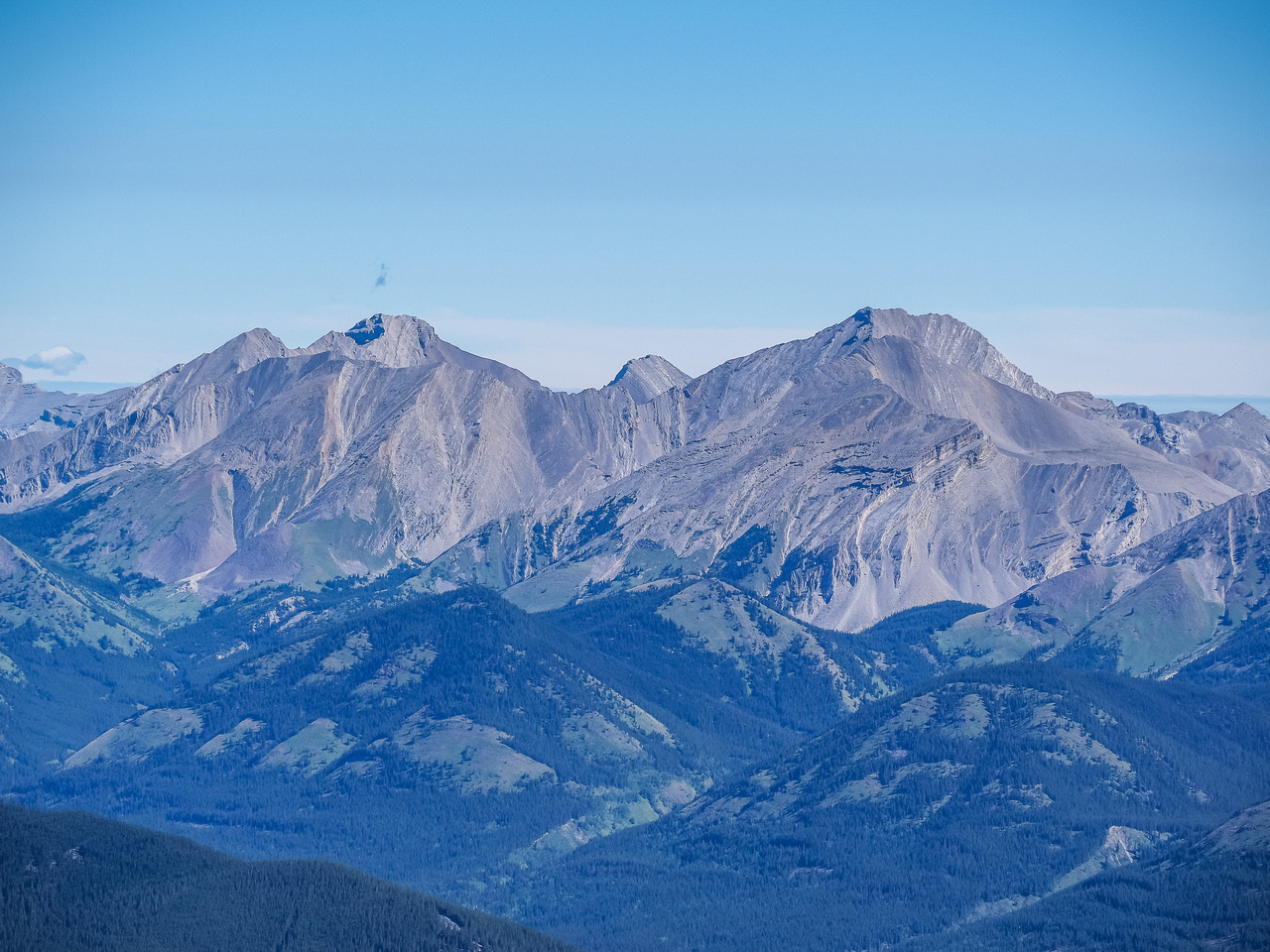 I believe this is Highwood Peak (R) and possibly Shunga-la-she at left.