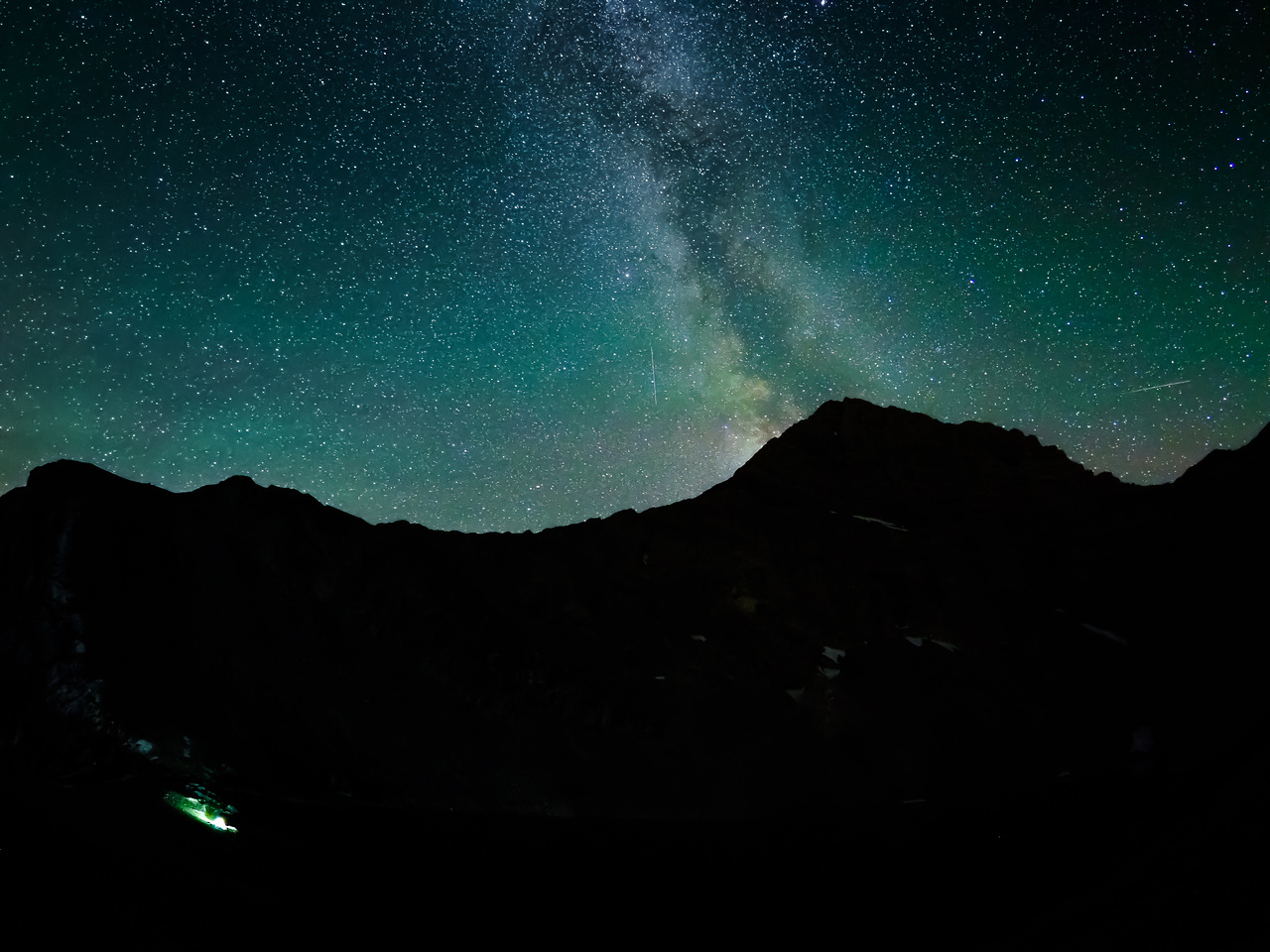The Milky Way rises over Mount McPhail. Our mid is lit up at lower left.