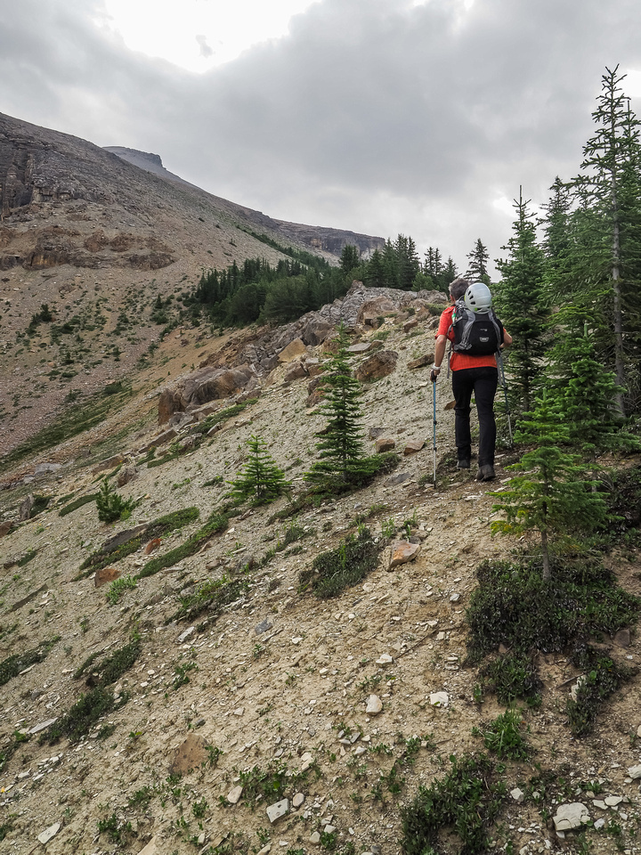 We skirt the forest just below the scree slope to South Totem's false summit.