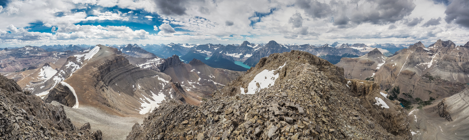 Spreading Peak at left and Bison at right with Mount Chephren rising over the false summit in the distance at center.