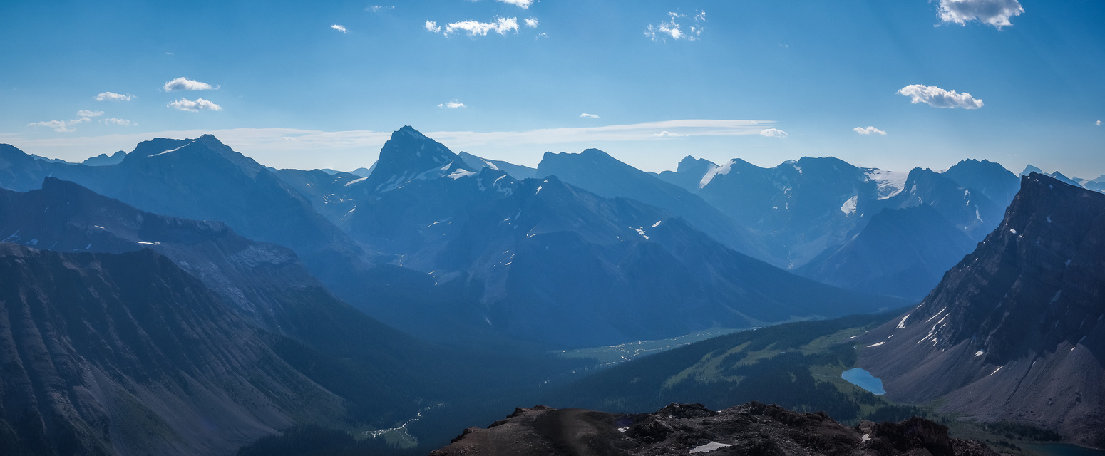 """Too bad about the haze, but from L to R, Little Cataract, """"Big"""" Cataract, McConnell and Mount Drummond. Lower Fish Lakes visible too with Minnow Peak at far right."""